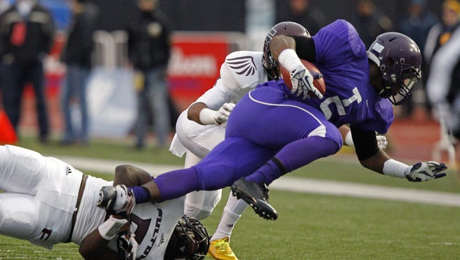Memphis Trezevant's Cordarrian Richardson, right, is tripped up by Fulton's Chaton Mobley in the Division I Class 4A Tennessee championship game on Dec. 6, 2014, in Cookeville, Tenn.
