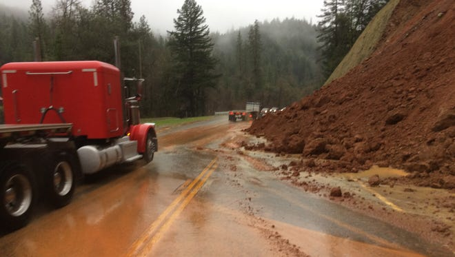 A rock and mudslide reduced traffic on Highway 299 to one lane about 25 miles east of Redding on Thursday.