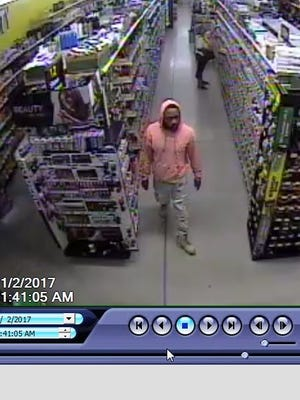 Surveillance photos of the man suspected of credit card fraud in Port St. Lucie.