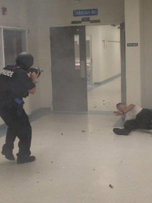 Pensacola Police Department officers trained at Booker T. Washington High School in June to prepare for active shooter situations.