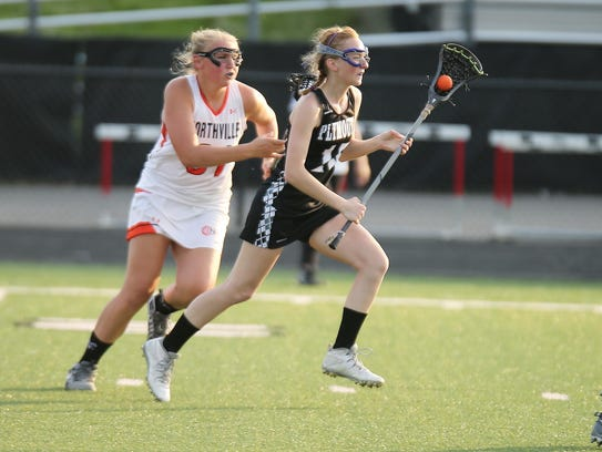 Plymouth's Cathryn VandenBosch (No. 15) maintains a