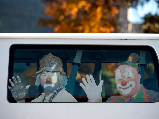 Stick-on images of Hadi Shrine Funsters decorate a van used for hospital transport outside the Hadi Shrine Temple in Evansville, Ind., on Thursday, Nov. 9, 2017. One of the Hadi Shrine's biggest volunteer efforts is transporting children and their families to the Shriner hospitals.