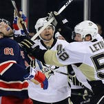 Kris Letang (58) of the Penguins gets the stick up on Rick Nash (61) of the  Rangers in a March 13 meeting.