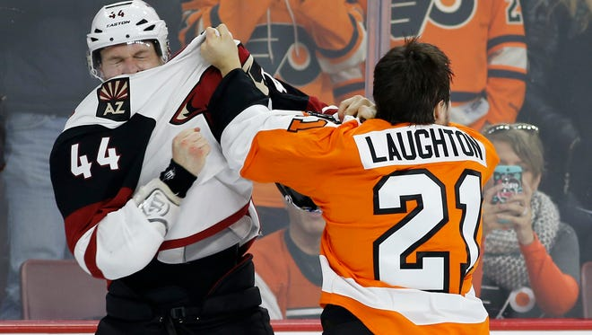 The Arizona Coyotes' Kevin Connauton, left, and the Philadelphia Flyers' Scott Laughton fight during the second period of an NHL hockey game, Saturday, Feb. 27, 2016, in Philadelphia.