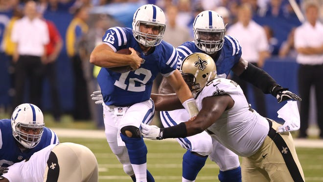 Andrew Luck scrambles against the Saints.