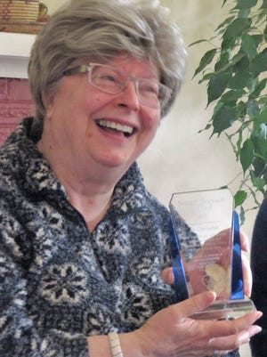 Oregon Prison Project volunteer Jill Cannefax of Salem received the Silent Servant Award from the Peter R. Marsh Foundation.