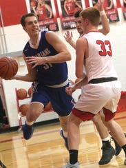 St. Peter's Jared Jakubick moves the ball past Mansfield