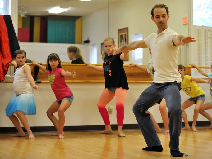 John Welker, the founder of the Atlanta Ballet Company's Wabi Sabi dancers, leads a group of children in basic ballet exercises Wednesday, July 23, 2014, at Baker's Studio of Dance in Lancaster. Welker and other members of the dance company taught and demonstrated ballet for children during a Lancaster Festival Major Arts for Minors workshop.