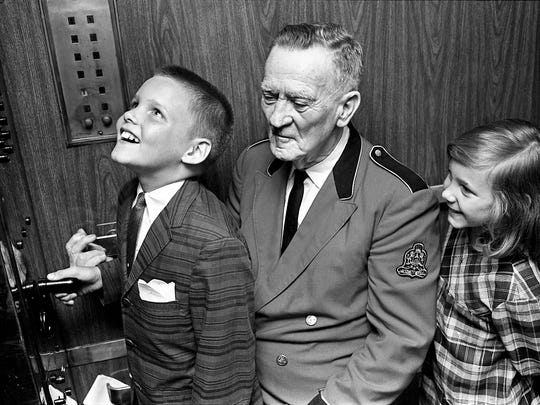 Darr Hall, 10, left, gets to run the Hermitage Hotel's elevator June 15, 1965 as operator Howard Slagle and sister Drusie, 8, looks on.