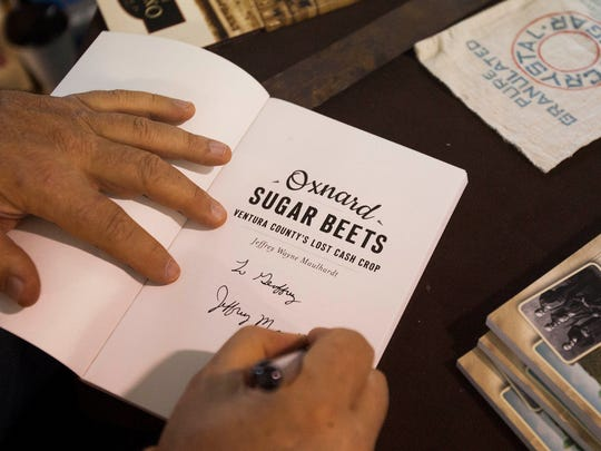 Oxnard resident and author Jeff Maulhardt signs a copy