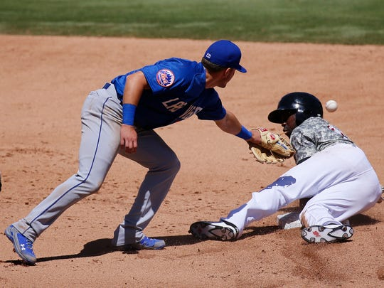 Las Vegas 51s second baseman Gavin Cecchini attempts the double play at second base earlier this season but scores an error as couldn't bring in the ball and Chihuahuas left fielder Jose Pirela reached the base safely. The 51s went on to win the game 2-0.