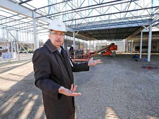 """Arvid Olson discusses the ongoing construction of the North End Community Center Thursday, November 30, 2017, on Elmwood Avenue between the former New Community School and Market Square in Lafayette. Olson said the $14.5 million, 114,000 square foot facility is slated for completion at the end of next summer. """"It really comes dow to a genuine love of our community. This community has been good to us, we want to be good to this community,"""" said Olson, who is director of development for Faith Ministries.""""If you're going to be relevant in this community, don't just talk about what you do, go meet needs."""""""