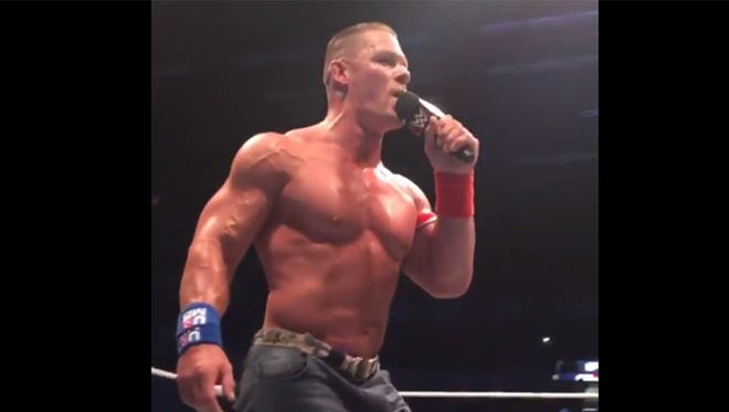 John Cena sings along with the crowd in West Virginia at a WWE house show.
