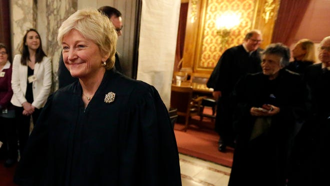 """Wisconsin Supreme Court Chief Justice Patience Roggensack  leads the other justices as they enter the Assembly chambers before Gov. Scott Walker's """"state of the state"""" address on Jan. 19, 2016."""