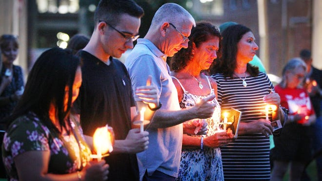 A candlelight vigil was held in 2018 at the Thomas Crane Library, in Quincy to raise awareness of those lost to overdose.