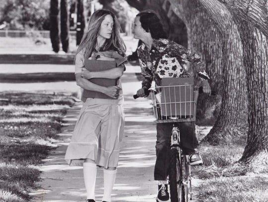 A boy (Cameron De Palma) torments Carrie (Sissy Spacek)