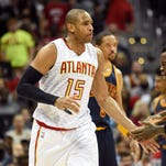 Atlanta Hawks center Al Horford (15) reacts with guard Dennis Schroder (17) after making a three point basket against the Cleveland Cavaliers.