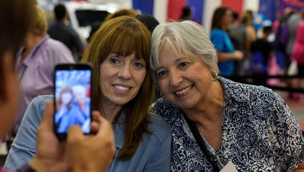 Mackenzie Phillips poses for a photo with a fan during