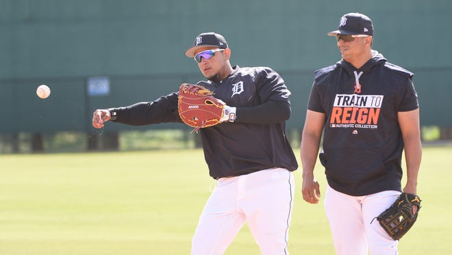 Tigers first baseman Miguel Cabrera, with Victor Martinez to his left, makes a throw to first after fielding the ball Sunday.