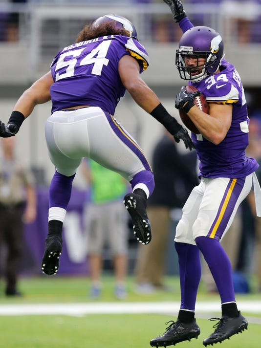 Minnesota Vikings strong safety Andrew Sendejo, right, celebrates with teammate Eric Kendricks, left, after intercepting a pass during the second half of an NFL football game against the Tampa Bay Buccaneers, Sunday, Sept. 24, 2017, in Minneapolis. (AP Photo/Jim Mone)