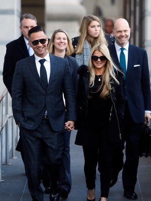 Mike 'The Situation' Sorrentino, breakout star of MTV's Jersey Shore leaves US Federal Courthouse in Newark hand in hand with his fiancee Lauren Pesce, followed by his legal team.  Sorrentino plead guilty today to federal tax charges, ending a more than three-year legal odyssey.. January 19, 2018. Newark, NJ.