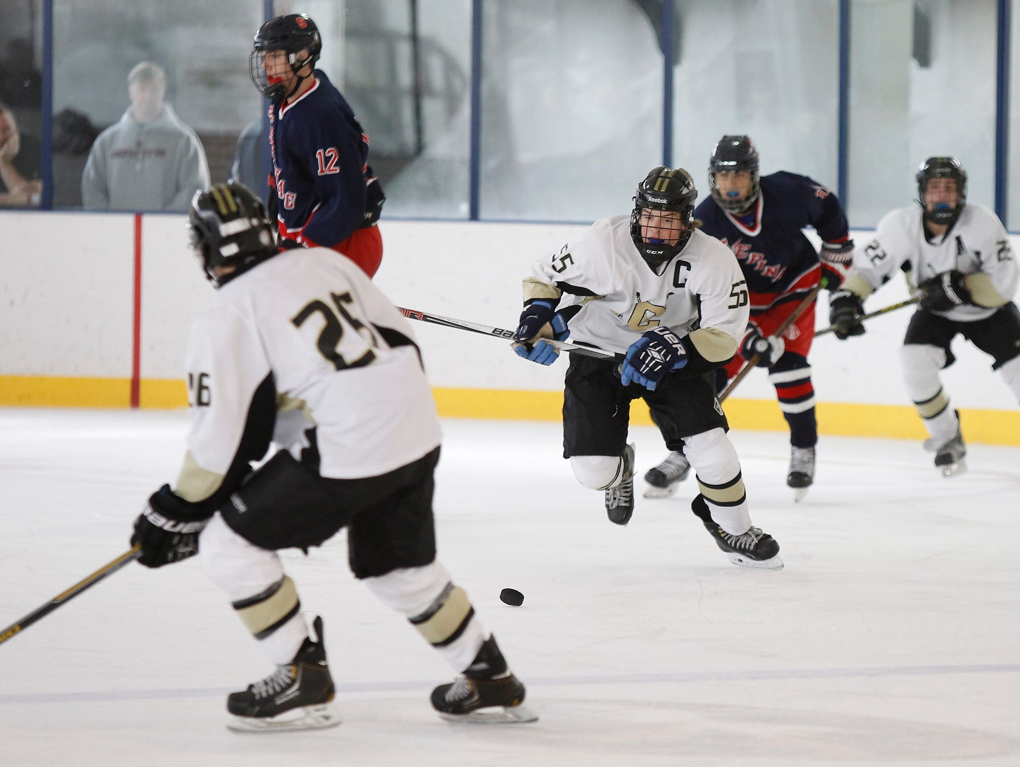 Clarkstown's Luke Myers (55) chases a loose puck during a varsity ice hockey game against Stepinac at the 2015 Guy Matthews Thanksgiving Invitational Hockey tournament at Ebersole Ice Rink in White Plains on Friday, Nov. 27, 2015.
