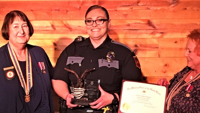 El Paso police Officer Andrea Zendejas is presented the 2018 Law Enforcement Officer of the Year award by Paula Mitchell, left, and Pauline Ballesteros of the El Paso Chapter of the Military Order of the World Wars.