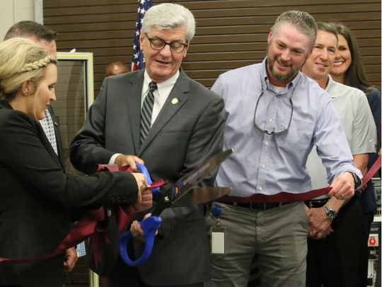 Mississippi Gov. Phil Bryant cuts the ribbon for the Industrial Electronics Technology Lab at Pearl River Community College-Forrest County Center on Thursday, June 13, 2018.