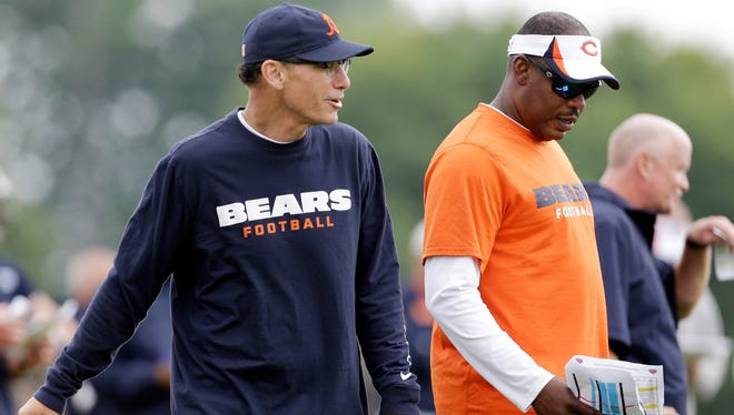 Coordinator Mel Tucker, right, is responsible for the Bears defense while new coach Marc Trestman focuses on the offense.