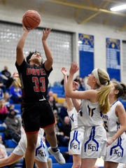 Dover's Rajah Fink shoots against Kennard-Dale in the