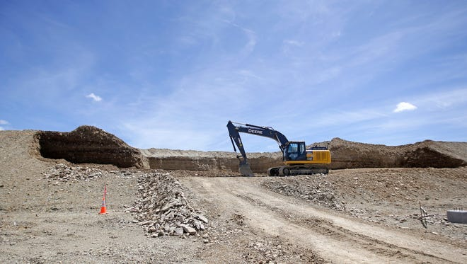 This July 13, 2015, photo, shows construction at the U.S. Oil Sands commercial tar sands operation, in the Book Cliffs, in eastern Utah. Utah state officials have given the go-ahead for the mine under construction the eastern flank of the state, but they will require the company to do water and air quality monitoring in a move environmentalists are calling a victory. (AP Photo/Rick Bowmer, file)