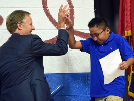 Gov. Bill Haslam congratulates student Brody Dean during