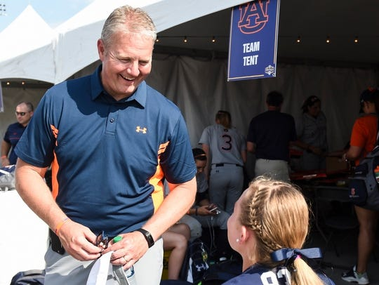 Jay Jacobs speaks to a fan at the SEC Softball Tournament semifinals in 2015 in Baton Rouge, La.