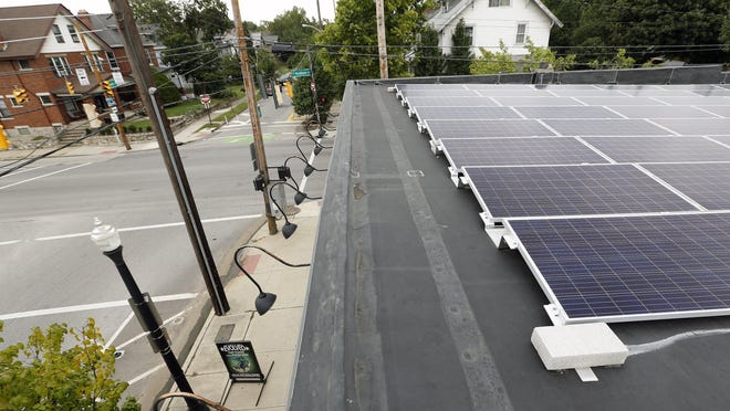 Evolved Body Art's solar panels provide power to the University District tattoo and piercing shop in 2018.