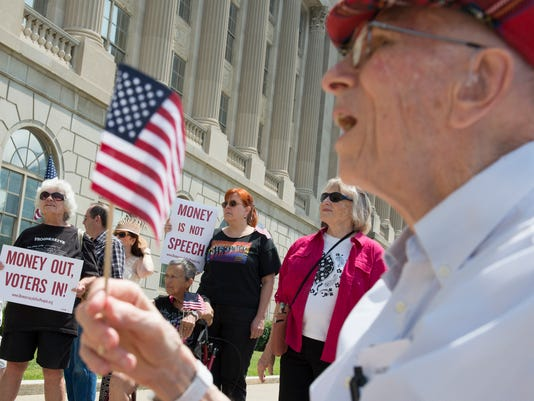Tom Moffett holds American flag at federal courthouse