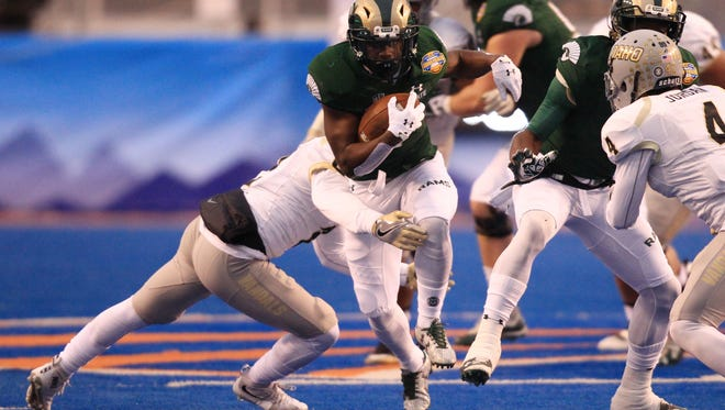 CSU running back Dalyn Dawkins breaks a tackle while running for a first down in the 2016 Idaho Potato Bowl in Boise. It was the fourth straight bowl appearance for the Rams, one shy of the school record.