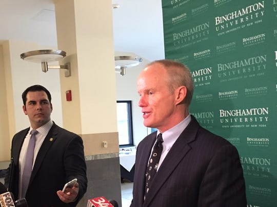 Southern Tier Regional Economic Development Council co-chairman Harvey Stenger, president of Binghamton University, fields questions after a meeting of the council at the university student union Tuesday.