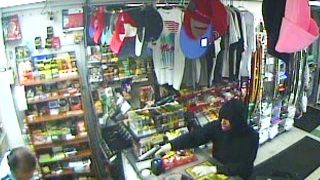 This man is one of three accused of robbing two businesses a few hours apart.