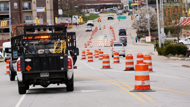Traffic barrels are placed along State Street west towards Chauncey Village Wednesday, March 29, 2017, in West Lafayette.