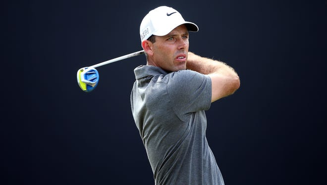 Charl Schwartzel of South Africa hits his tee-shot on the third hole during the final round of the DP World Tour Championship. Schwartzel is leading the final round of the Alfred Dunhill Championship.