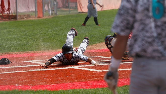 Justin Watari of the Farmington Frackers slides in safe at home plate for a run against the Maryland Monsters during Saturday's Stan Musial World Series semifinals game at Brighton High School in Brighton, Colo. Matt Hollinshead/The Daily Times
