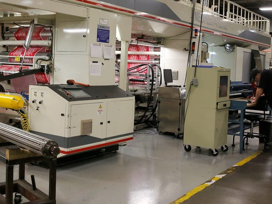 A four color printing press prints bags at ProAmpac in Springdale Monday November 21, 2016. ProAmpac is one of Greater Cincinnati's largest privately held companies. The company's headquarters is based in Springdale with manufacturing plants all over the world.