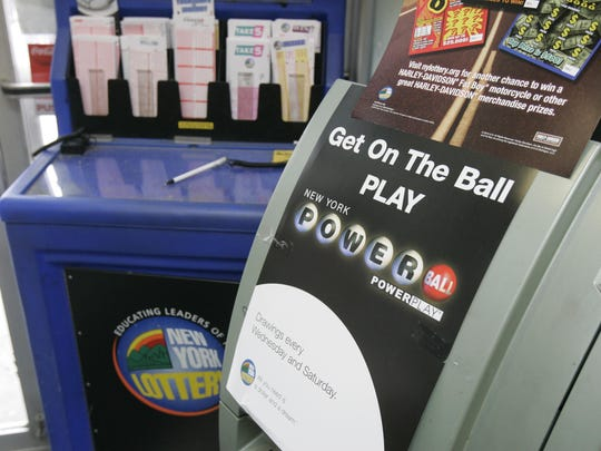 A promotional poster for the Powerball game sits next