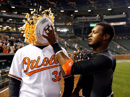 Baltimore's Adam Jones, right, hits teammate Matt Wieters