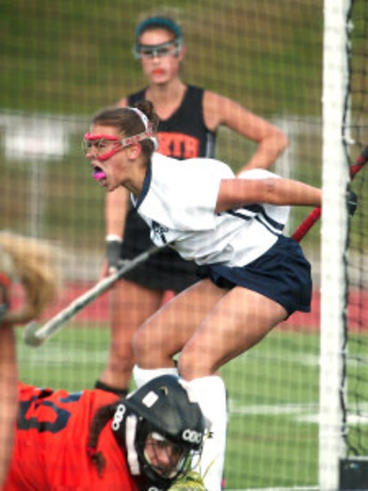 Mendham's Samantha DiMaio celebrates after scoring in a NJSIAA North 2 Group III field hockey matchup. Staff photo by Bob Karp/Daily Record