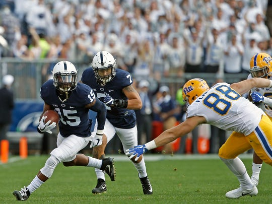 Penn State's Grant Haley (15) looks for running room after an interception against Pittsburgh during the first half of an NCAA college football game in State College, Pa., Saturday, Sept. 9, 2017. (AP Photo/Chris Knight)