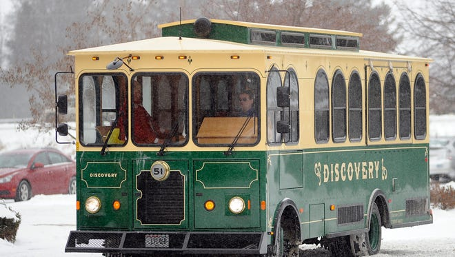 """In this HTR Media file photo, parents and their children take a ride on a Discovery trolley as they listen to a reading of """"The Polar Express"""" over the speakers on their trip from the Holiday Inn to the Wisconsin Maritime Museum."""