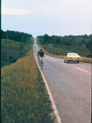 John Karras and Donald Kaul bike from Des Moines to Iowa City in 1971 — two years before they founded the Register's Annual Great Bicycle Ride Across Iowa (RAGBRAI). Here, George Anthan leads the line of bicyclists up a hill just outside of Iowa City.