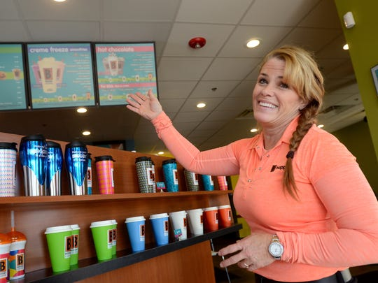 Co-owner Jackie Brooks talks about the menu choices Monday, Jan. 25, at the new Biggby Coffee location in Fort Gratiot.