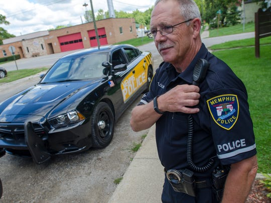 Officer and school liaison Terry Blount talks about his squad car Monday, Aug. 30, in Memphis.